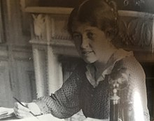Ka writing at her desk, undated