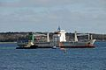Kent Explorer with a tug and fishing boat in Halifax Harbour, Nova Scotia, Canada.jpg