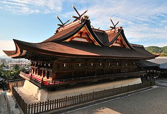 Shinto architecture - Kibitsu Shrine's honden-haiden complex. The main entrance (hidden) is on the right.