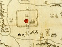 Old map made by hand-painting. Names of buildings and mountains are written in Chinese characters, and accompanied with small icons. On the center, 慶州 is put on a red circle.