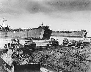 Battle of Noemfoor - U.S. Army M4 Sherman tanks and other vehicles disembarking from LSTs onto Noemfoor.