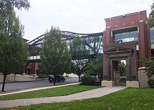 Lewis and Clark High School - 2001 classroom addition and new skybridge to the field house.  Historic entry to the former administration building is in the foreground.  View is looking southeast with S. Stevens Street visible.