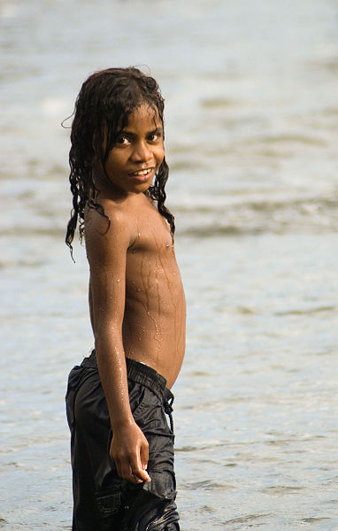 Long haired boy on the beach at Melanesia Long hairstyle