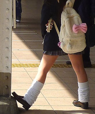 Japanese street fashion - A kogal identified by her loose socks and shortened skirt
