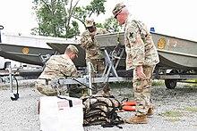 Louisiana National guard loading supplies on a boat
