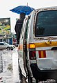 Lusaka Bus Conductor During Rainfall.jpg