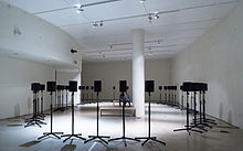 Rows of speakers displayed in a gallery.