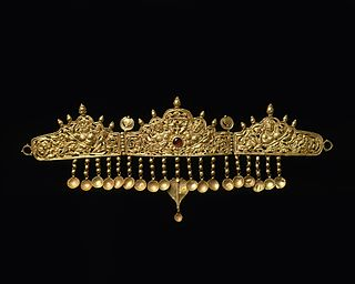 Ornamental headband worn by monarchs and others as a badge of royalty