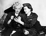 Marilyn Monroe aboard Air Force Jet to Korea 1954.jpg