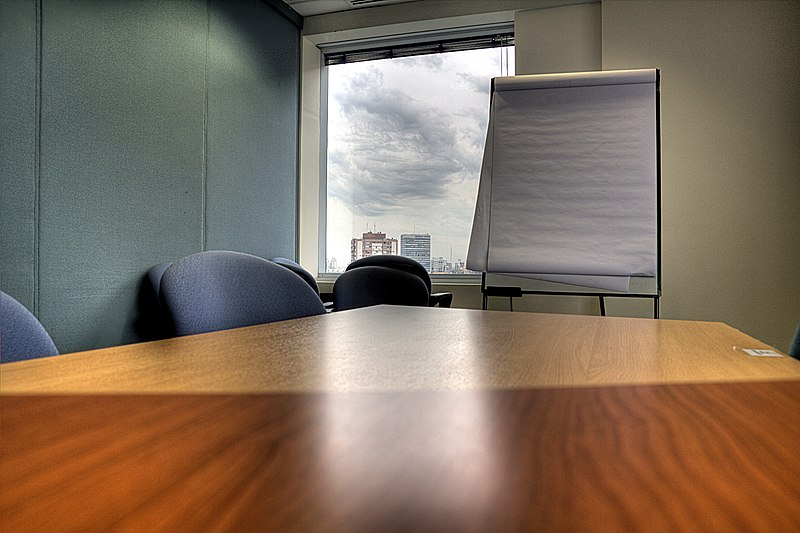 File:Meeting room, table and paper board.jpg