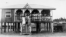 Members of the Country Women's Association gather on the verandah and steps of the CWA hall, Goomeri, ca. 1927.jpg