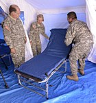 Members of the Georgia State Defense Force set up a portable patient bed.jpg