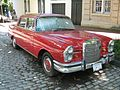 Mercedes-Benz 230S red 4-D fr.jpg
