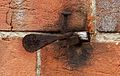 Metal on a brick wall.jpg