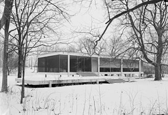 Farnsworth House - A winter view of the house in 1971, showing the original insect screening of the porch, and the roller shades added by the owner after the curtains were damaged by flood waters.