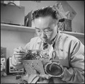 Minidoka Relocation Center, Minidoka, Washington. Radio repair shop. Henry Tambora, radio repairman. - NARA - 536540.tif