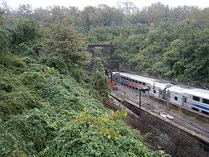 North River Tunnels - Image: NJT NEC enters Hudson Palisades