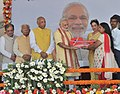 Narendra Modi presents the house keys to beneficiaries at the inauguration of the New Housing Scheme, in Chandigarh. The Governor of Punjab and Haryana and Administrator, Union Territory, Chandigarh (2).jpg