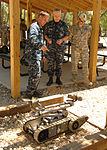 Naval Explosive Ordnance Disposal School student explains robots 120425-N-DA827-004.jpg