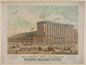 Head house - The Reading Terminal in Philadelphia, showing a 9-story brick head house to the right and arched train shed (with market below) to the left.