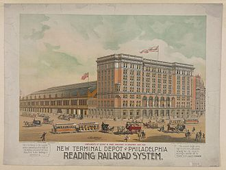Head house - The Reading Terminal in Philadelphia, showing a nine-story brick head house to the right and arched train shed (with market below) to the left.