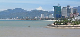 Photograph of Nha Trang beach with many high rise buildings behind it
