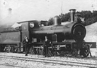 "North Mount Lyell Railway - North Mount Lyell Railway Avonside 4-6-0 No. 1 ""J. Crotty"" at Kelly Basin, circa 1900"