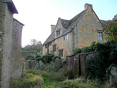 Cotswold stone walls and mullioned windows of Buckland Manor Hotel.