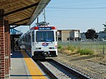 Northbound Blue Line TRAX at Meadowbrook station, Aug 16.jpg