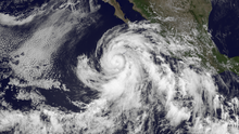 A visible satellite image depicting sprawling Hurricane Cosme on June 25.