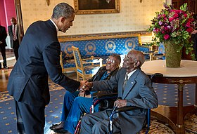 Obama greets Richard Overton with Earlene Love-Karo.jpg