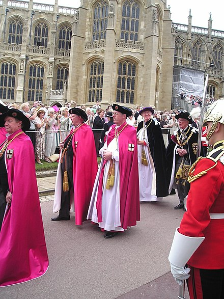 Officers of the Order of the Garter (left to right): Secretary (barely visible), Black Rod, Garter Principal King of Arms, Register, Prelate, Chancellor. Officers of the Order of the Garter.JPG