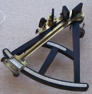 Octant (instrument) - Octant. This instrument, labelled Crichton - London, Sold by J Berry, Aberdeen, appears to have an ebony frame with ivory scale, vernier and signature plate.  The index arm and mirror supports are brass.  Rather than use a sighting telescope, this instrument has a sighting pinnula.