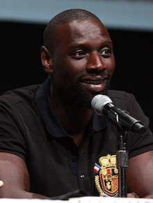 Omar Sy - the cool, friendly, fun, enchanting, enigmatic,  actor, comedian,   with Mauritanian, Senegalese,  roots in 2019