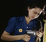 Operating a hand drill this woman worker is shown working on the horizontal stabilizer (cropped).jpg