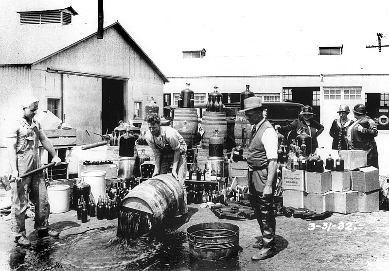 Orange County Sheriff's deputies dumping illegal booze, Santa Ana, 3-31-1932