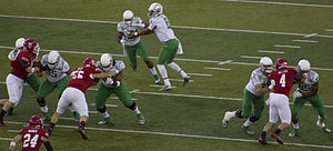2014 Oregon Ducks football team - Marcus Mariota hands the ball off to Thomas Tyner.