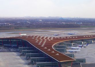 """Star Alliance - Star Alliance members Scandinavian Airlines, Lufthansa, Austrian Airlines (with Star Alliance livery), and Air China (in the field) using Terminal 3E of Beijing Capital International Airport as part of the """"Move Under One Roof"""" program to co-locate alliance members"""