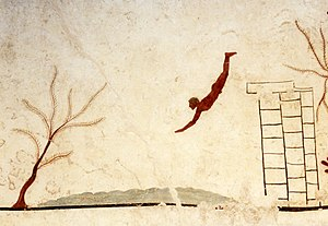 Tomb of the Diver - Detail from the underside of the top slab of the grave, showing a man diving into waves .