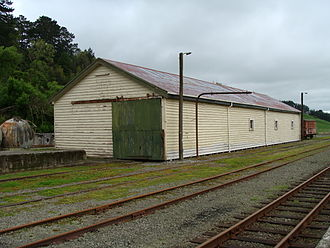 Pahiatua railway station - Pahiatua railway station goods shed and loading bank. This is the only surviving original building on site, and was completed in 1897.