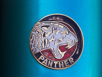 Logo of a Panther B8 motorcycle.
