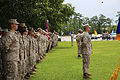 Passing the cutlass, senior enlisted sailor passes the sword in a change of charge ceremony 130618-M-IU187-038.jpg