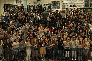 Pep rally - A group of students cheering and clapping at their high school pep assembly.