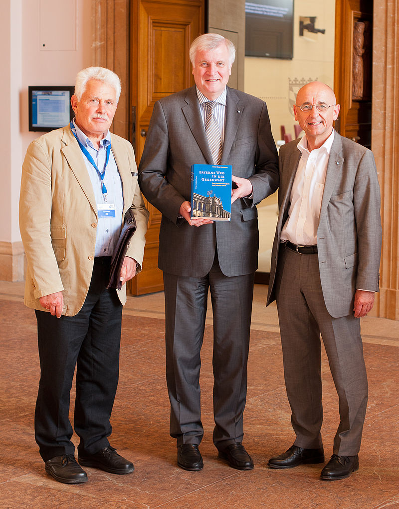 Peter Claus Hartmann with Horst Seehofer and Alfred Sauter 2012.jpg