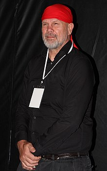 FitzSimons wearing trademark red bandanna at a film premiere, February 2013