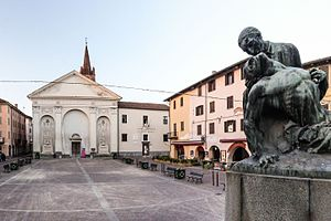 Carmagnola - Piazza Sant'Agostino, War Memorial on the foreground and Sant'Agostino church on the background