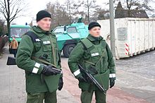 99ecc2d0e5 German Policemen in bulletproof vests on guard duty at a military hospital.