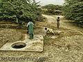 Poor child play in dirty water.jpg