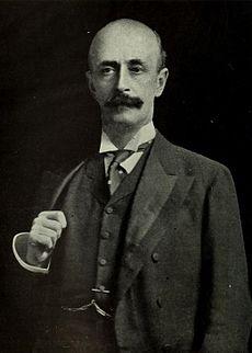 A Victorian-looking, balding moustachioed gentleman.