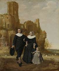 Portrait of a couple with their child in a landscape